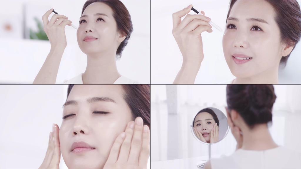 4K用化妆品保养皮肤的美女视频素材