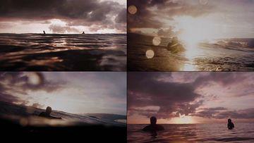 黄昏在海面上游泳的人剪影视频素材