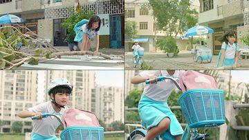 教育骑单车的小女孩