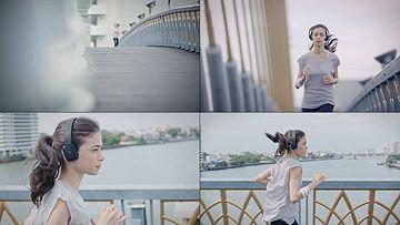 戴上耳机跑步的女人