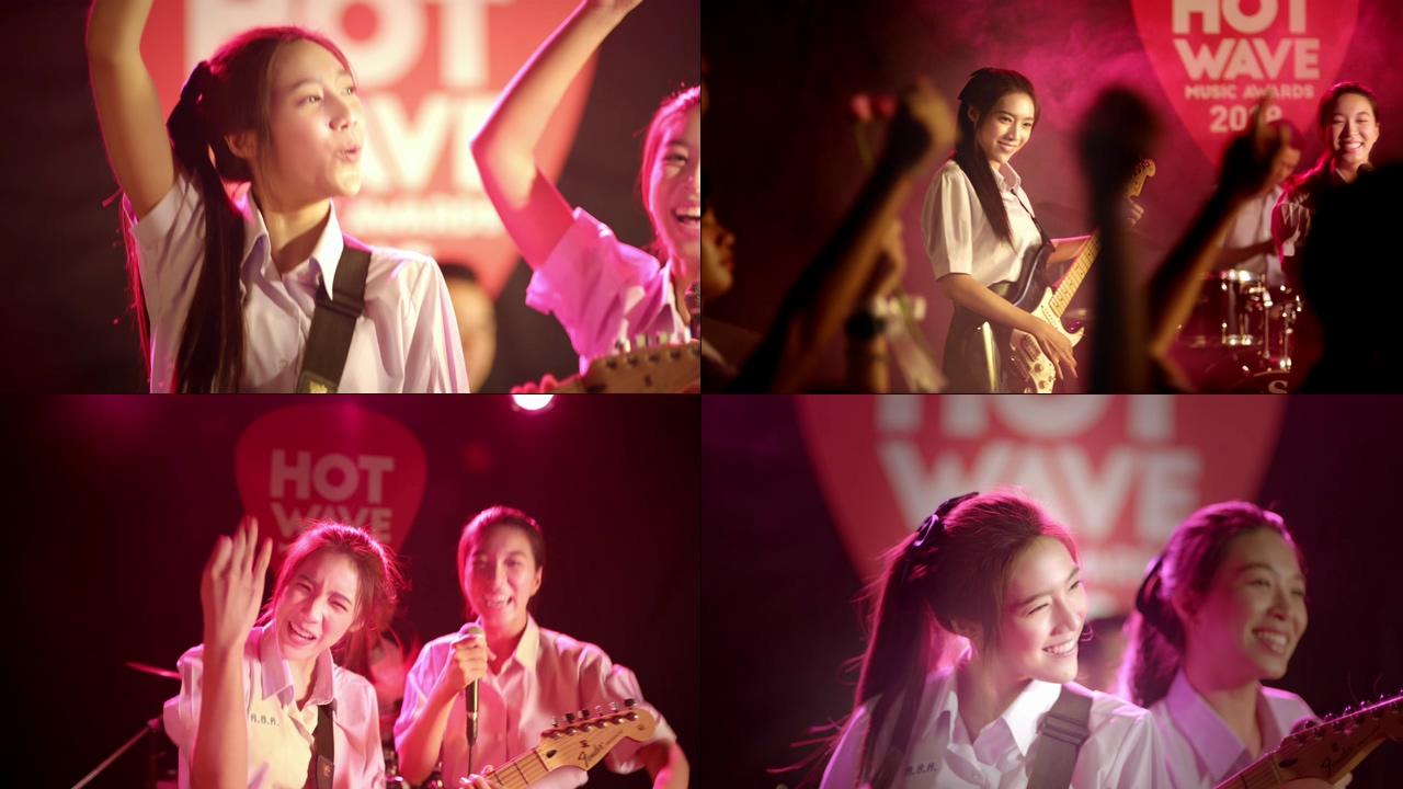年轻快乐的女孩弹吉他视频素材