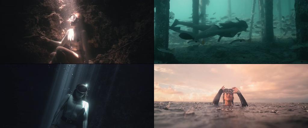 唯美潜水的美女浮出水面