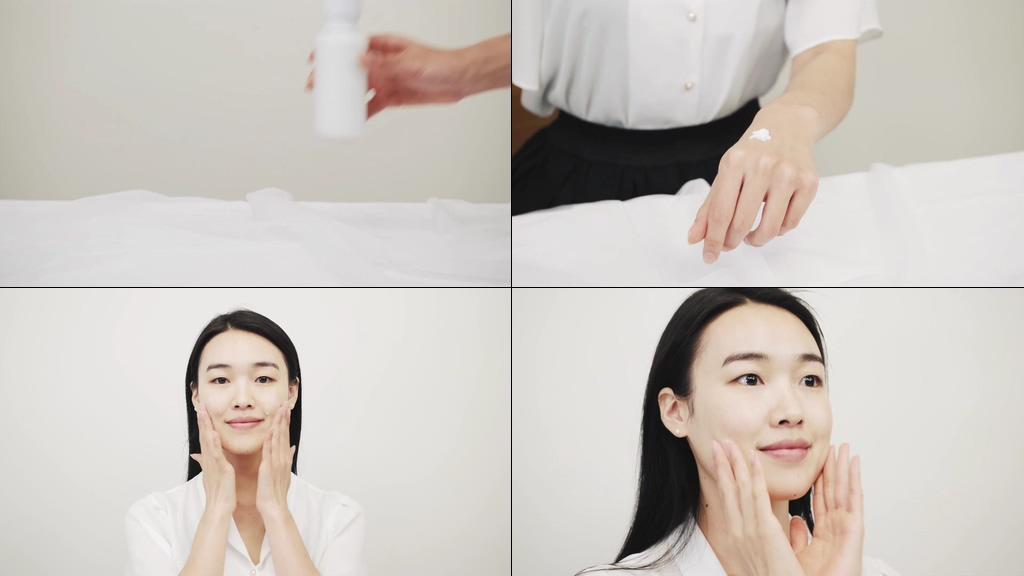 涂乳液护肤霜的美女视频素材