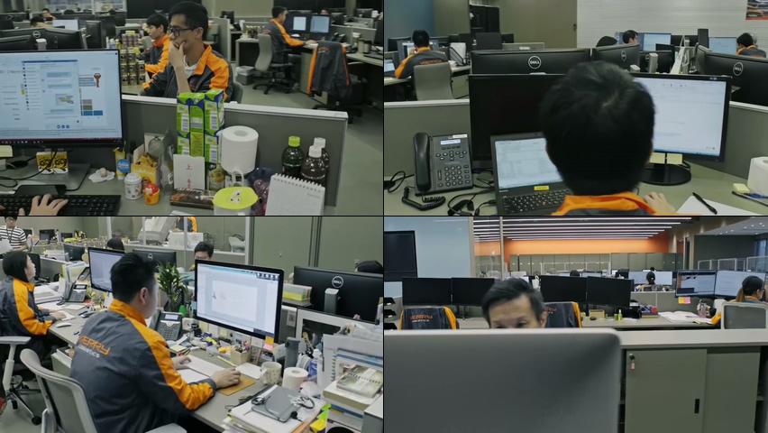公司环境办公桌上的工作人员