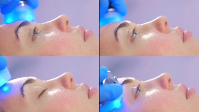 在美容院做光子护肤蓝光照射视频素材