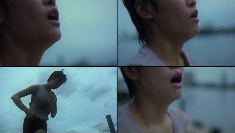 深呼吸跑步大汗淋漓的短发女人视频