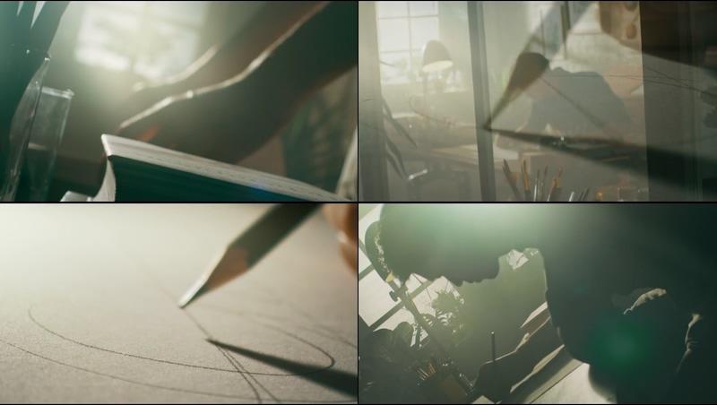 唯美夕阳光线下设计绘画的男人视频素材