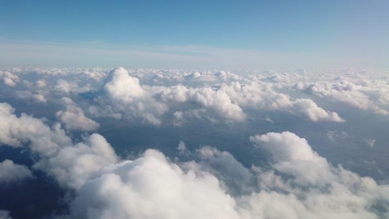 4K飞机视角一朵朵白云视频素材